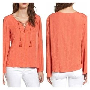 Cupcakes & Cashmere | Jett Lace-Up Bell Sleeve Top